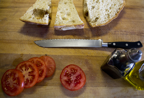 Cut the bread and tomato
